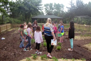 Truman MAE students teach a lesson outdoors to students in the summer school program.