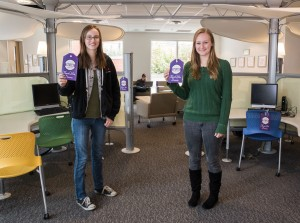 Students Kaitie Otto (left) and Abagale Casagrande show off two of the many tags that were placed  around campus to highlight donor contributions.