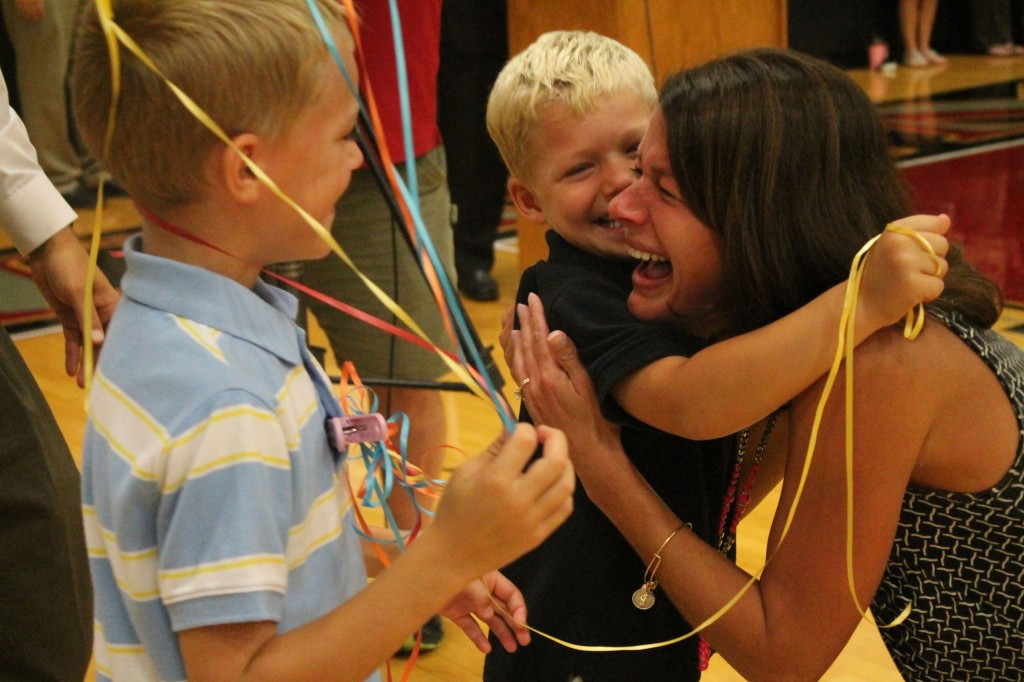 ABOVE: Jamie Manker shares a moment with her two sons, Kyle (7) and Tyler (5) after learning she was named the Missouri Teacher of the Year. (Photo by Mary Thaier, Rockwood Summit, Talon Newspaper)