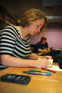 Kate Ramatowski ('04, '05) goes over interview notes with Hazelwood West High School student Kyle Raup.