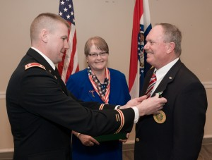 Roger Marsh, right, accepts his Army Commendation Medal from Lt. Col. Steven Petersen. Marsh's wife Irmgard, center, was by  his side during the ceremony, which took place Feb. 18 on campus.