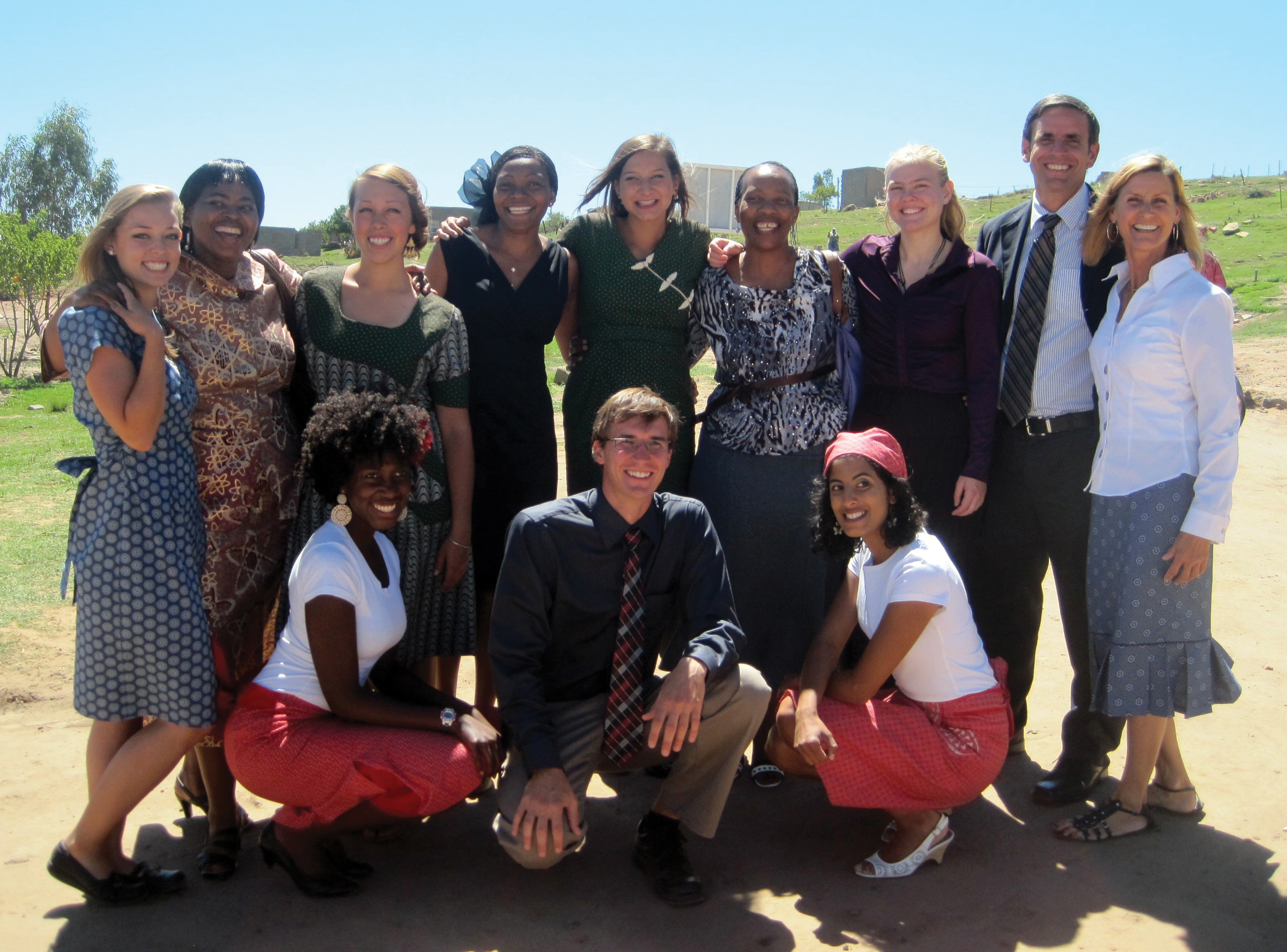 "After two months of in-country training, Sadie Nelson ('11), pictured far left, and members of her training group enjoy their day of ""swearing in"" as official Peace Corps volunteers in Lesotho, South Africa. Nelson applied to the Peace Corps shortly after graduation. Her in-country training included passing a language proficiency test of the country's official language, Sesotho. Through a new partnership between the University and the Peace Corps, Truman students who volunteer can also work toward their master's in leadership during service time."