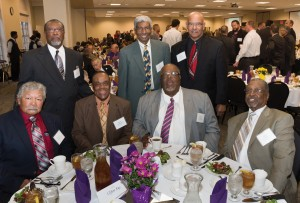 Professional educators, and longtime friends from their time as students, reunite at the Homecoming Banquet in October. Seated, left to right: Peter Leu, Sharron Washington, George Simmons and Alvin Smith. Back row, left to right: Leroy Bonner, Clifton Ray and Wayne Clinton.